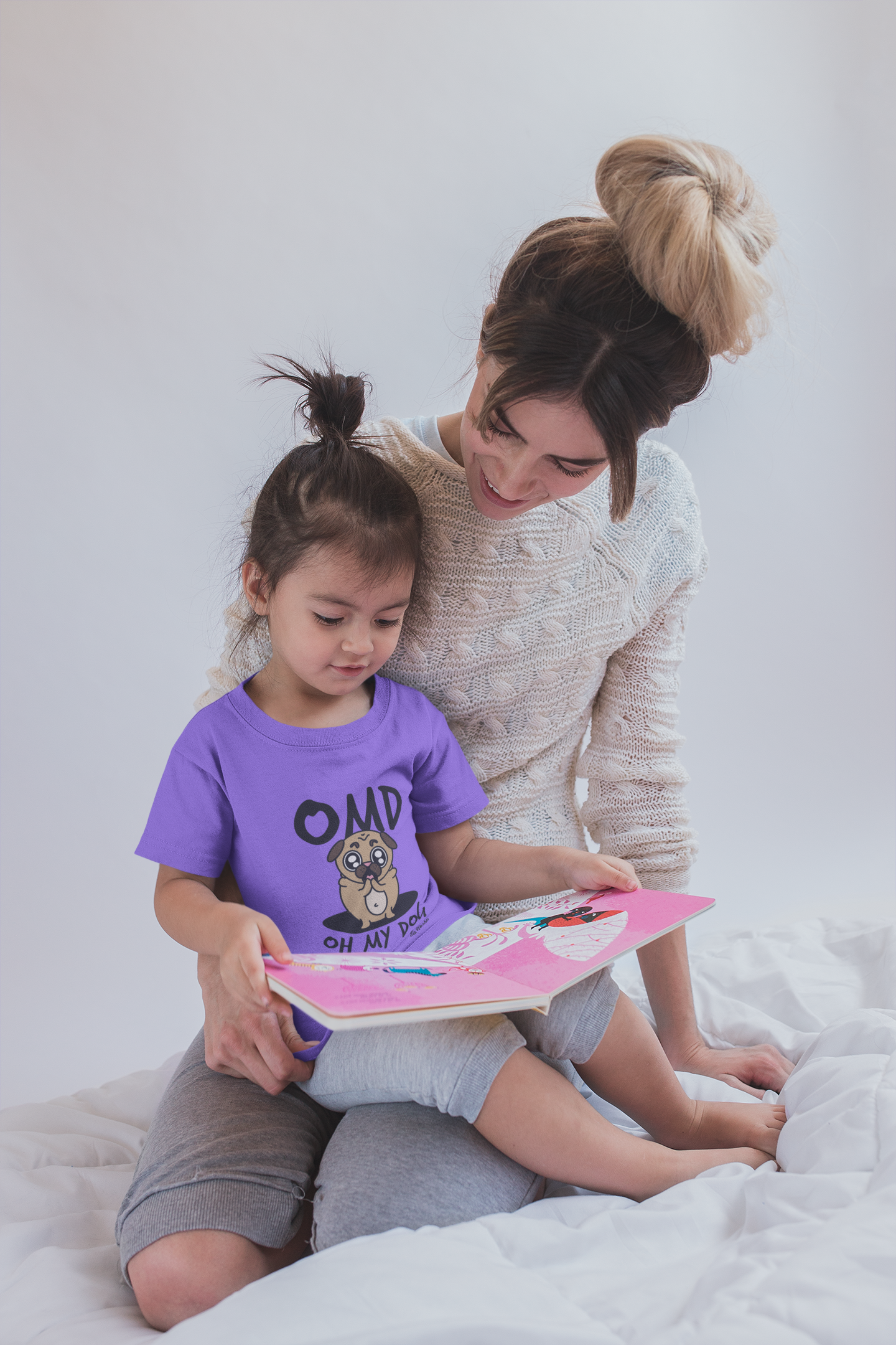 girl-reading-a-book-wearing-a-t-shirt-mockup-with-her-mom-sitting-on-bed-a20285